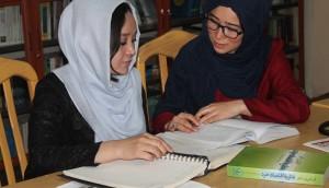wec-women-studying