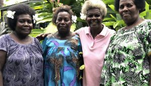 Dorcas, Anna and Clara outside the HAKO Resource Centre and Safe House. The safe house has seen a spike in clients seeking assistance from family violence since the pandemic